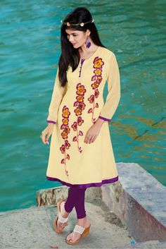 Party Wear Georgette Kurti in Cream Colour.It has Round Neck,Full Sleeves.It is crafted with Embroidery Design...