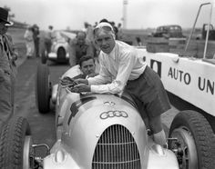 German driver Bernd Rosemeyer stands beside his Auto Union C at the 1937 Vanderbilt Cup, which he would go on to win. It was the last race until 1960.