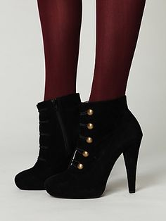 i can't get enough of high heeled booties, the military accents make these shoes dream-worthy