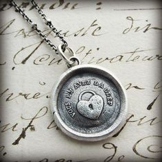 """A charming French heart padlock wax seal necklace with the French inscription """"Vous En Avez La Clef, """"Thou Hast the Key"""" to my Heart. Such a lovely sentiment for so many occasions."""