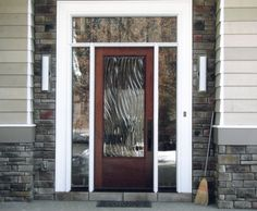 "Front Entry featuring Sculptural Glass Door, ""Viento"" design"
