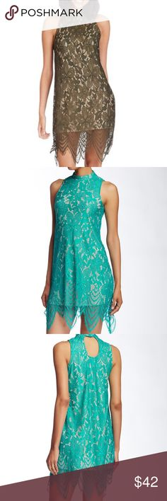 """Fire Mock Green Neck Scallop Dress Tonal lace scallops the hem of a sleeveless mock neck mini dress, ideal for outdoor parties.  - Mock neck  - Sleeveless  - Allover lace  - Back keyhole with button-and-loop closure  - Scalloped hem  - Lined  - Approx. 32"""" shortest length, 37"""" longest length  - Imported Fire Los Angeles Dresses"""