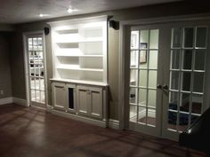Future family room/porch || Built-in shelving and glass French doors