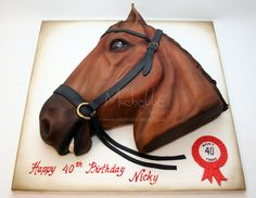 That decapitated horse head cake looks as if it has a tear in its eye. Can't blame it.