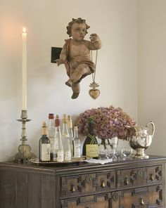 Hanging cherubs from ceiling.  Maybe surrounding C-mas tree.  I have 3.