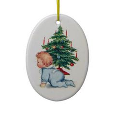 Vintage Christmas Ornament  Just adorable! A beautiful baby boy dressed in blue crawls in front of a Christmas Tree. Lovely oval Ch...