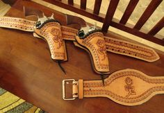 My new Cowboy Mounted Shooting holsters custom made by John Kaye of Yoakum, TX.  My last name is Rose so they're perfect.  I freaking love them!!!