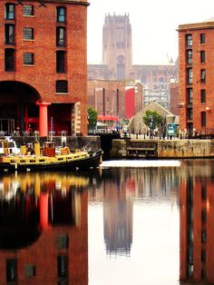 The Albert Dock (regenerated, once run down area in the city centre) with the Anglican cathedral in the background