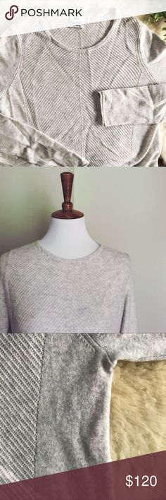 "Vince • Cashmere Pullover Sweater Long, soft, cozy cashmere sweater. Very light heather gray, almost white in color. Side panels are solid, and the front and back are a semi-sheer Open Knit in a chevron pattern. Very good used condition - the only flaw is some pilling where the arms brush against the body of the sweater. 29"" length // 29"" Sleeve length Vince Sweaters Crew & Scoop Necks"