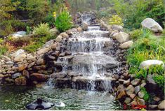 The lush back gardens designed by Atlanta-based landscape architect Bruce Wells include a waterfall cascading into a koi pond. Description from pinterest.com. I searched for this on bing.com/images