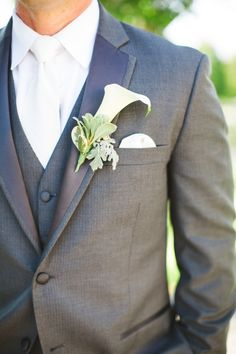 crisp charcoal and white groom look with simple boutonniere http://www.weddingchicks.com/2014/02/06/thursday-club-wedding-yellow-inspiration/
