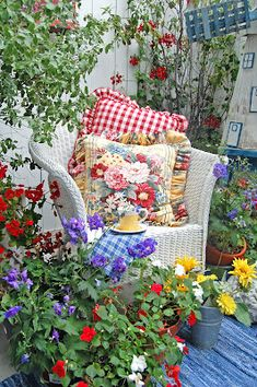 Painted Garden ~~~  Vintage pillows and white wicker -  a sweet place to sit.