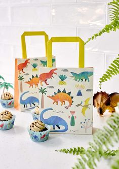 Fill with dino-mite treats for the little ones to take home after the dino party. Each pack contains 8 treat bags with eye-catching and bright dinosaur print. Shop the Party Dinosaur collection for dino-spiration. Dinosaur Party Supplies, Dinosaur Birthday Party, Birthday Party Games, Party Box, Party Packs, Pochette Surprise, Paper Party Bags, Dinosaur Cupcakes, Happy Birthday Video