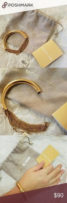 """Michael Kors Rose Gold Bracelet 100% AUTHENTIC! NEW WITH TAGS IN MICHAEL KORS JEWELRY POUCH! MICHAEL KORS Women's Luxe Rose Gold Tone Stainless Steel Chain Fringe Bracelet Style # MKJ5789791 MSRP - $115.00 Stainless Steel Fits 7"""" Wrist 7 Rose Gold tone Chains Strands Magnetic Closure Signature Michael Kors Cubic Zirconia Crystal MK Original Pouch and Care Guide Michael Kors Jewelry Bracelets"""