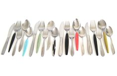 New to LaurasLastDitch on Etsy: 1950s 1960s Stainless Flatware Set Mismatched Atomic Starburst Turquoise Pink Mint Green Yellow Black Handle Service for 4 Serving Pieces (99.99 USD)