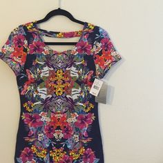 NWT printed bodycon dress Hello stunner! Absolutely stunning Hawaiian flower printed bodycon dress with cut out in back. Short sleeve cotton dress that will hug you in all the right places  Felicity & Coco Dresses Backless