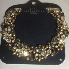 """NWT Zara Goldtone Smoke Clear Statement Necklace NWT Zara Goldtone Smoke Clear Statement Necklace brand new and unworn. Huge chunky piece. It about 17"""" long with a 2-1/2"""" extension. The stones are smoky and clear with a lot of mate goldtone  pieces. Not for the faint of heart. It is made up of 15 small pieces connected on the back of piece. Will come on the original card as shown. Price is FIRM unless bundled. NO TRADES NO KIDDING Zara Jewelry Necklaces"""
