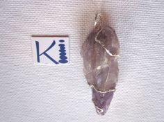 Raw Auralite 23 Amethyst Pendant Wire by KiCrystalCreations Amethyst Pendant, Sterling Silver Jewelry, Wire, Drop Earrings, Crystals, Crafts, Manualidades, Crystals Minerals, Handmade Crafts