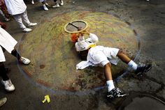 A Sikh boy displays his skills with a 'Chakkar' as he performs 'Gatka,' an ancient form of Sikh martial art,