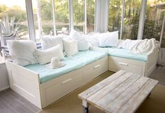 DIY stained wood coffee table on casters. Steampunk meets shabby chic meets beach cottage meets industrial modern style.
