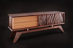 Mack - The Big Brother of the five Sisters, this walnut with zebra wood credenza mixes modern and organic with a unique three sided design. Available as a wall-hung piece. by Jory Brigham