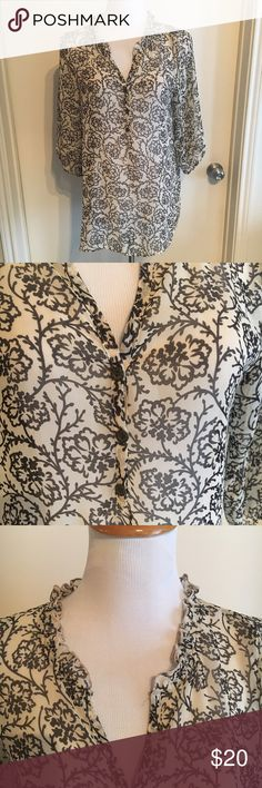 Francesca's Floral Long Sleeve Blouse AnaBe Francesca's Blouse in excellent condition featuring a beautiful vibe scroll Floral pattern.  Cream and black colored. Cute buttons at the v-neck. 3/4 sleeves. Ruffle around neck. Really Boho and cute. Fits like an 8/10. Only worn a few times! Francesca's Collections Tops Blouses