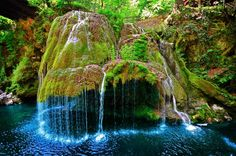 """(Want to See.) The locals call this waterfall """"the miracle from the Minis gorge."""" The moss formation which the falls travel over is 8 meters tall, creating one of the most beautiful waterfalls in the world."""