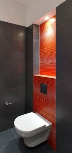 Neat splash of red tile., chocolate. Brown tile , wall hung. Toilet. I adore this