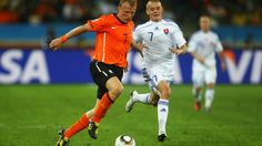 DURBAN, SOUTH AFRICA - JUNE 28: Dirk Kuyt of the Netherlands and Vladimir Weiss of Slovakia battle for the ball during the 2010 FIFA World Cup South Africa Round of Sixteen match between Netherlands and Slovakia at Durban Stadium on June 28, 2010 in Durban, South Africa. (Photo by Lars Baron/Getty Images)
