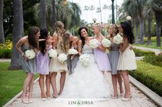 Love the bride's dress and the different colors of the bridesmaids' dresses!