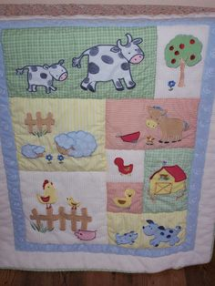 This is one of my Finds... Measures approx. 42 x35 .. Appliqued farm animals. Waffle weave border ... backed with green plaid. Light weight