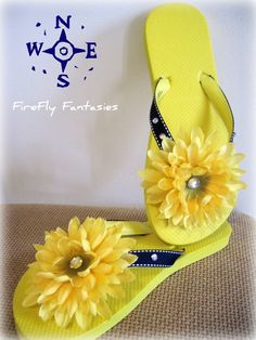 Sailors Delight - Nautical Yellow Flower Beach Flip Flops / Sandals with Navy Blue Ribbon and Rhinestones. $19.95, via Etsy.