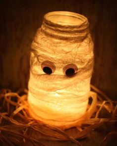 Mason Jar.. Tea light... Wrap with gauze, add two eyes.. Cute and simple, for a walkway or steps.