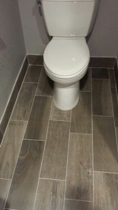bathroom baseboard ideas. tile baseboards in bathrooms, mudroom, laundry room. shown here gray tile. ryan likes bathroom baseboard ideas pinterest