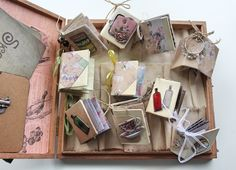 Lena Holmstrom is our very own mini-book maker; she can create those smallbeauties in many different designs - one prettier than other. Having amassed quite a sizeable collection, she needed a box to house at least some of them. With the help of Architextures elements and some Canvas Corp garland, Lena made not only some more of her gorgeous mini-books but also turned an old cigar box into their ...