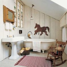 Early 20th-century fixtures mingle with plank walls, a vintage medicine chest, and a weathervane in an early dwelling.  Photo: Gross & Daley