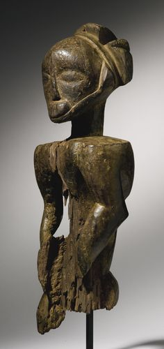 HEMBA-KUSU MALE ANCESTOR FIGURE, DEMOCRATIC REPUBLIC OF THE CONGO H. 57 cm THE COLLECTION OF ALLAN STONE: AFRICAN, PRE-COLUMBIAN & AMERICAN INDIAN ART - VOLUME TWO Sotheby's, New York, 16 May 2014 Sold 7,500 USD