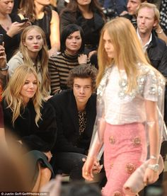That's my girl! Harry Styles only had eyes for Cara Delevingne as she rocked the runway at the Burberry Prorsum spring/summer 2014 show in London