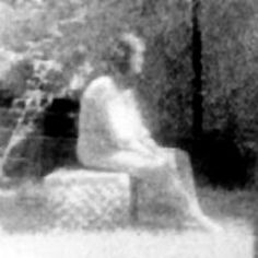 """One of those """"too-good-to-be-true"""" photos, this one actually has a pretty good pedigree because it was shot by a professional paranormal investigator (and notice it was also taken in broad daylight, as opposed to most cemetery investigations which are almost always shot at night). The picture was taken at the Bachelor's Grove Cemetery in Illinois by the Ghost Research Society on August 10, 1991. Photographer Mari Huff was using high-speed monochromatic film in the area where their equipment had"""
