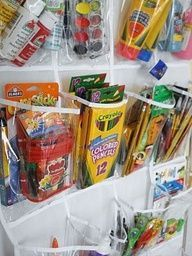Think outside the toy Box - Over 50 Organizational Tips for Kids Spaces- Did this shoe organizer on Judes closet door today for all of his art supplies and randomness and I love it! I think I am going to get another one to put on the back of the basement door to organize junk drawer stuff and randomness!!!! Love!