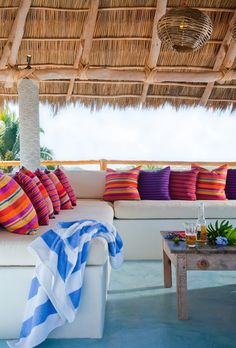 covered patio with built in bench seating and brightly colored pillows :: WEEKEND ESCAPE: A HOLIDAY HOME IN SAYULITA, MEXICO | THE STYLE FILES