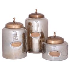 """Set of 3 smoked glass canisters with hammered textures. Product: Small, medium and large lidded canisterConstruction Material: GlassColor: Smoked silverFeatures: Hammered textureDimensions: Small: H x DiameterMedium: H x DiameterLarge"""" H x Diameter Copper Canisters, Glass Canisters, Rose Gold Kitchen, Kitchen Jewels, Kitchen Canister Sets, Kitchen Essentials, Kitchen Gadgets, Kitchen Tools, Furniture Styles"""