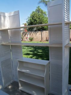 craft show booth display.craft booth: 2 sets of shutters two shelves and a (folding? Vendor Displays, Craft Booth Displays, Vendor Booth, Market Displays, Store Displays, Display Ideas, Jewelry Displays, Retail Displays, Antique Booth Displays