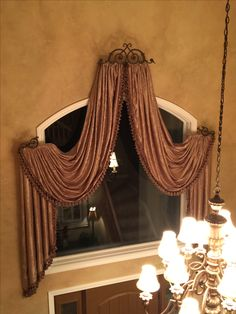 Beautiful crushed silk swags with tassel trim. Lifted swags for a 2 story entry.