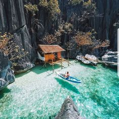 Now how about this waterfront vacation home! Would you live here? We love this little ocean hut perched into the rock formations of Palawan, in the Philippines. Photo by Vacation Places, Dream Vacations, Vacation Spots, Beach Vacations, Beach Travel, Vacation Trips, Beautiful Places To Travel, Cool Places To Visit, Places To Go