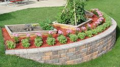 A yard with a steep slope can be difficult to landscape. Build a block retaining wall to add level tiers to your yard, which prevent erosion and provide a perfect place for a flower garden.