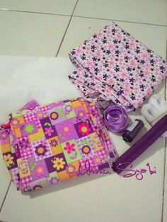 this is my first try to begin make something. prepare to sewing flova purple pouch. wait the result.