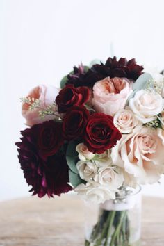 Textured bouquet in white, blush, peach, and burgundy. | Whim Florals