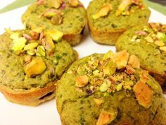 GREEN MUFFIN MADNESS!  INGREDIENTS:  - 1 banana  - 1 cup oat flour (take dry oats and blend them up until they become flour)  - 1 egg  - 1 TSP nonfat plain greek yogurt  - 1 Cup spinach  - 1 tsp cinnamon  - 1/8 cup Stevia or honey  - 1 TSP of crushed Pistachios  DIRECTIONS:  Mix it all up in a food processor or blender (except for the pistachios), then pour into a muffin tin. You may add fruit chunks if you'd like. I added whole blueberries. Then top with the nuts. Bake for 10-15 min at 180C…