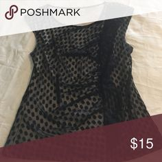 🌸Black and tan blouse with ruffle detail Black and tan sleeveless blouse with ruffle detail, good condition, has slight pilling. Tops Blouses